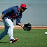Cleveland Indians' Michael Bourn fields a ball during a workout before a spring training exhibition game against the Cincinnati Reds, Thursday in Goodyear, Ariz.