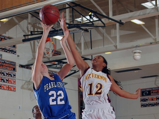 Pearl River's Kari Portington (22) puts up a shot and is blocked by Curstyn Moore (12) during the Dr. Lynn Kahn Holiday Classic at White Plains High School on Dec. 8, 2012.