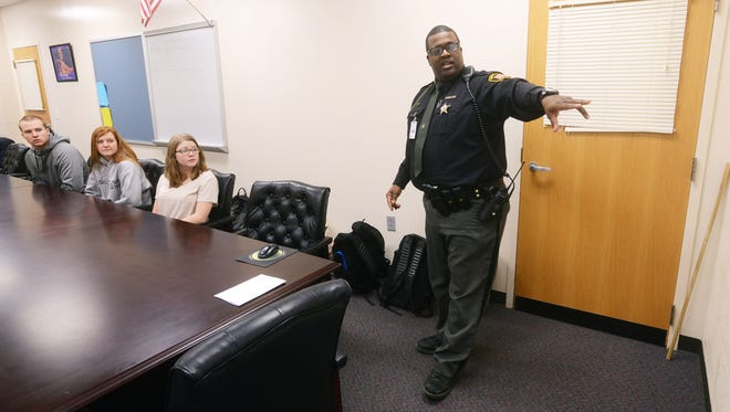 Muskingum County Sheriff's Deputy John Howe talks to a group of Maysville High School students on Thursday. Howe, the school's resource officer, also helps teach criminal justice classes at Maysville.