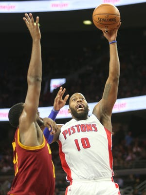 Pistons  forward Greg Monroe scores against Cavaliers forward Tristan Thompson during the second period of the Pistons' loss Tuesday at the Palace.
