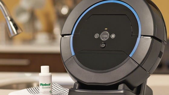 The iRobot Scooba 450 floor scrubbing robot in its cleaning dock