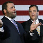 Gov. Chris Christie (right) on Tuesday urged Democrat Cory Booker (left) and the state's congressional delegation to oppose a deal aimed at curbing Iran's nuclear weapons development.