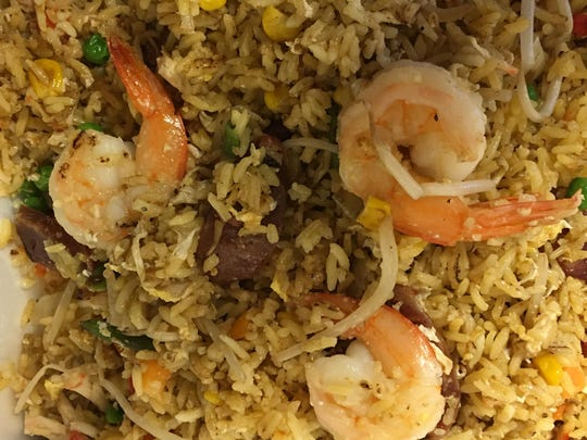 Southern style fried rice features Vietnamese sausage, roasted pork and shrimp.
