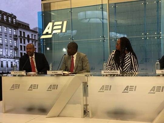 "Panelists respond to the ""Black Men Making It in America"" report  during its June 26, 2018 release at the American Enterprise Institute in Washington, D.C. From left, Bradley Hardy, Ian Rowe and Michelle Singletary.  The report says the majority of black men make it into at least the middle class by their 50s."