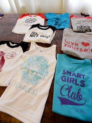 Some of the gender-neutral clothing made by Courtney Hartman is displayed at her home in Seattle.
