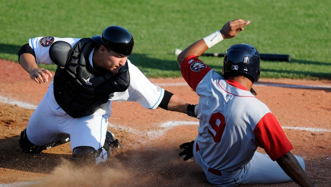 Hudson Valley Renegades' Chris Talley tags out Brooklyn Cyclones' Joe Tuschak on Tuesday at Dutchess Stadium in Fishkill. Renegades' left fielder Bralin Jackson made the throw home.