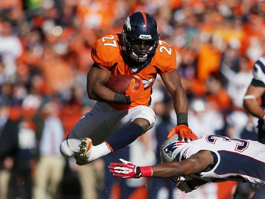 Middletown native Knowshon Moreno leaps over a New