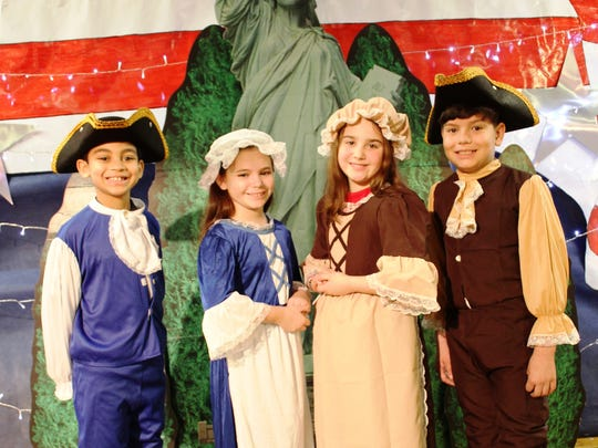 St. Francis Cathedral School third and fourth graders held their annual Patriotic Program on Wednesday, Feb. 21, 2018. The children performed, sang and celebrated our great country with many veterans from all branches of service. Pictured from left to right are: Christian Johnson, Ilenia Brereton, Isabella DePasquale and Oscar Casas.