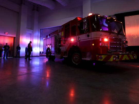 Gov. Scott Walker is driven to the stage in a Pierce Manufacturing fire engine on Monday at the annual Governor's Conference on Tourism on at the Fox Cities Exhibition Center in Appleton. Danny Damiani/USA TODAY NETWORK-Wisconsin