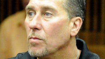 Cleared in '87 slaying, man charged with assault