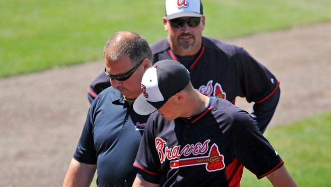 Kris Medlen, here leaving his March 9 start with elbow discomfort, may find out Monday that he will definitely require Tommy John surgery to repair his elbow.