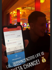 Donte DiVincenzo shows his bank account numbers to Bucks teammate DJ Wilson. Those numbers are about to change.