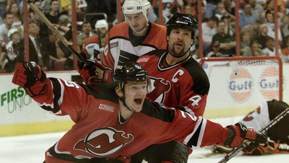 New Jersey Devils' Patrick Elias, front, and Scott