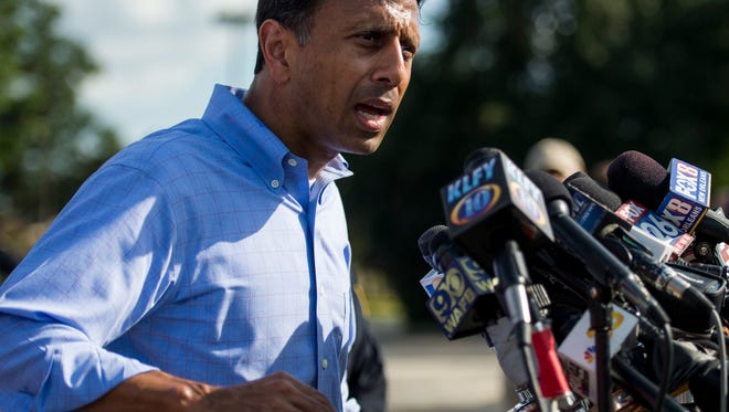 Louisiana Governor Bobby Jindal addresses the media during a news conference at the Grand 16 Theatre in Lafayette, La., Friday, July 24, 2015. Two victims were killed and an additional nine were injured in a shooting at the theater on Thursday evening.