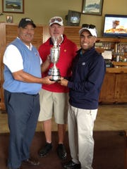 Damon Green (center) holds Claret Jug with Osceola general manager/pro Adrian Stills (left) and his son Justin.