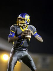 Records quarterback DJ Phillips prepares to throw the ball during a Region 1-5A semifinal game against West Florida at Gene Cox Stadium on Friday.