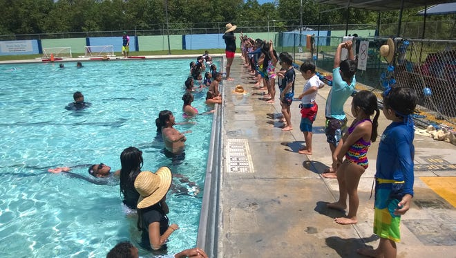 Participants line up at the Hagåtña Pool for the Summer Youth Swimming and Water Safety Program.