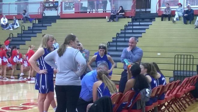 The Cedar Crest girls basketball team huddles during Monday night's district playoff loss at Wilson.
