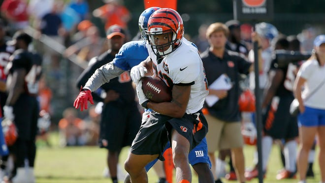 Cincinnati Bengals wide receiver Marvin Jones runs for extra yards after making a catch during joint 11-on-11 drills with the New York Giants during Cincinnati Bengals training camp, Wednesday.