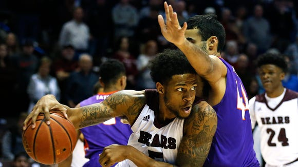 Missouri State Bears forward Obediah Church tries to drive past Evansville senior David Howard on Wednesday at JQH Arena in Springfield, Missouri.