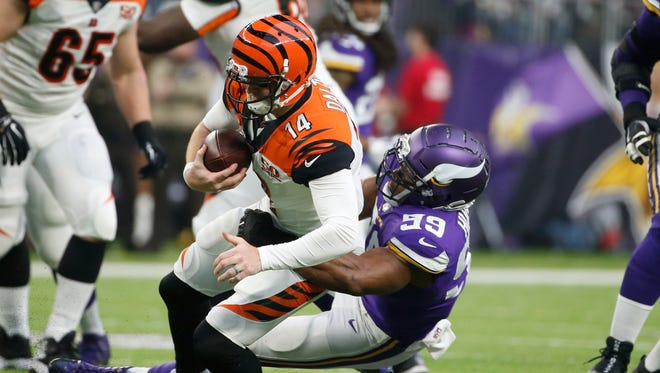 Bengals quarterback Andy Dalton is sacked by Vikings defensive end Danielle Hunter during the first half of last week's loss.