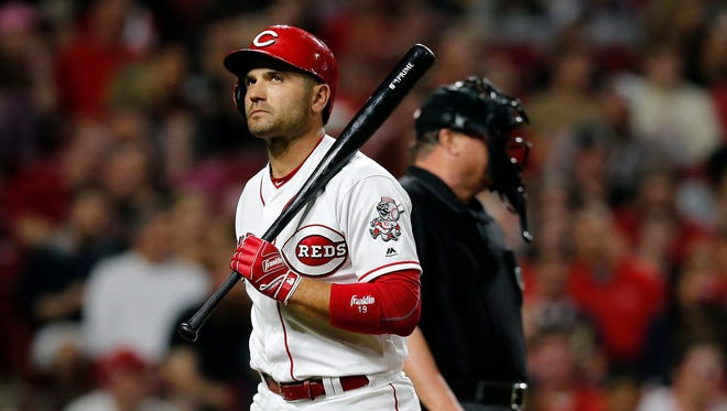 Cincinnati Reds first baseman Joey Votto (19) returns to the dugout after striking out in the bottom of the seventh inning of the MLB National League game between the Cincinnati Reds and the Miami Marlins at Great American Ball Park in downtown Cincinnati on Friday, May 4, 2018. Raisel Iglesias tallies a save as the Reds win 4-1.