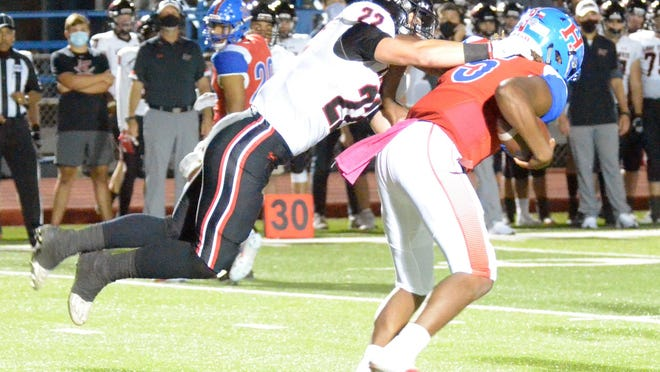 Lake Travis linebacker Wesley Erwin sacks Hays quarterback Durand Hill in the first quarter of Friday's District 26-6A game at Bob Shelton Stadium in Hays County. Sophomore quarterback Bo Edmundson threw for 459 yards and six touchdowns on 23-of-27 passing in the Cavs' 70-35 win.