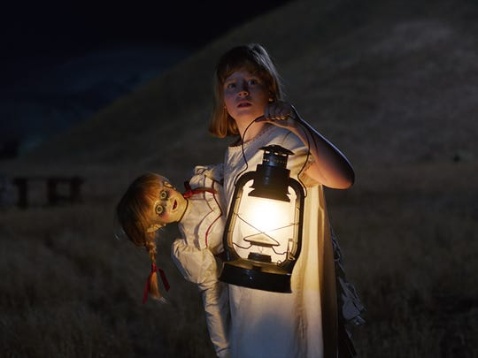 Annabelle before being thrown into the well in 'Annabelle: