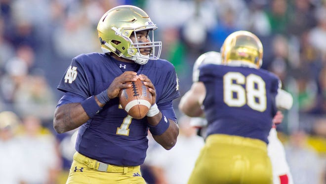 Notre Dame Fighting Irish quarterback Brandon Wimbush (7) drops back to pass the ball in the second half of the game against the Miami (Oh) Redhawks at Notre Dame Stadium.