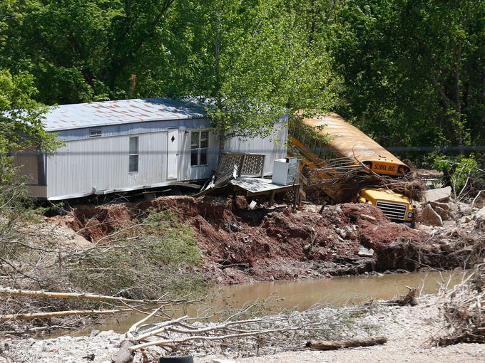 A school bus was swept away by flood waters and landed