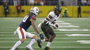 Oregon safety Jevon Holland (8) intercepts a pass in front of Auburn wide receiver Sal Cannella during the first half of last year's season opener in Arlington, Texas. [The Associated Press]