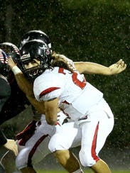 North Salem's Jason Villoria (19) runs with the ball