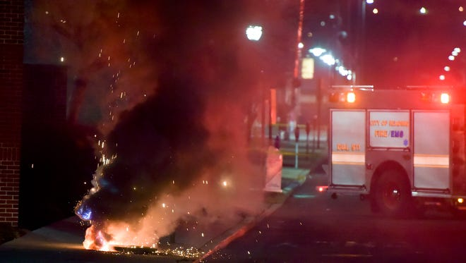 An underground power line fire prompted explosions that caused flames to shoot several feet into the air from manholes in Reading, Pa., Wednesday night, March 1, 2017. Crews worked several hours to extinguish the underground power line fire.