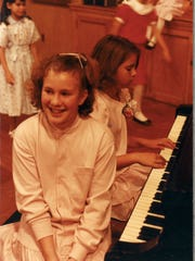 Carolyn Murnick, foreground, and her childhood friend,