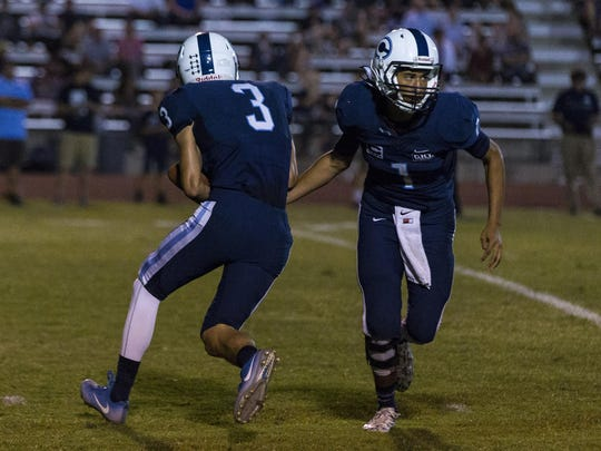 CVC quarterback  JJ Lino hands off to Gavin Salierno on a reverse in the first half of the game against Lindsay earlier this year.