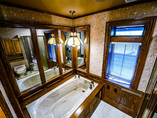 One of the bathrooms in the English Tudor home at 504