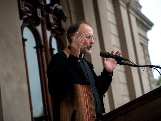 Father Fred Thelen, pastor at Cristo Rey Church, leads