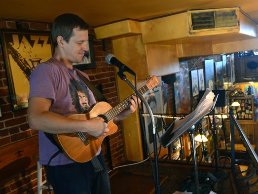 Julian Ruck, of Port Huron, plays a song on his ukulele