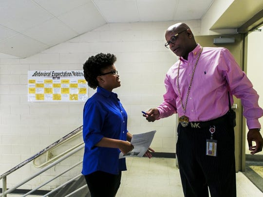 May 13, 2016 - Whitehaven High School junior Anitra Higgins, 17, listens to principal Vincent Hunter while discussing her desire to run for senior class president. Shelby County Schools is creating a pilot program in Whitehaven called the Empowerment Zone. It's an extension of the iZone, designed as a low-cost turnaround program that leverages the leadership from Whitehaven High School across the entire Whitehaven community. The district can't afford to put every school in the iZone, so this is a trial to see what other things can be accomplished in order to aid struggling schools. (Yalonda M. James/The Commercial Appeal)