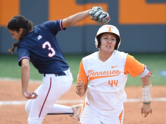 Tennessee's Abby Lockman (44) runs for first base past Arizona's Danielle O'Toole (3) during an NCAA softball tournament Knoxville Regional game at Sherri Parker Lee Stadium on Saturday, May 21, 2016. Arizona won 4-0.