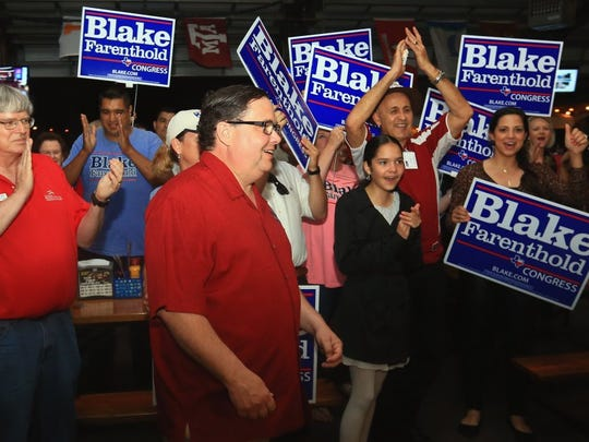 GABE HERNANDEZ/CALLER-TIMES U.S. Representative District 27 incumbent congressman Blake Farenthold smiles as supporters cheer him on before doing an interview Tuesday at Brewster Street Ice House.