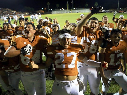 GABE HERNANDEZ/CALLER-TIMES Alice players celebrate after defeating Flour Bluff on Friday, Sept. 23, 2016, at Memorial Stadium in Alice.