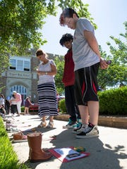 Superintendent Lisa Savoia, and eighth graders Anthony Mimes and Jacen Shores read the bios at Keyport High School's one-day memorial to school shooting victims across the U.S.
