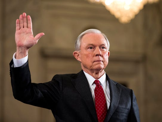 Then-senator Jeff Sessions prepares to testify at his