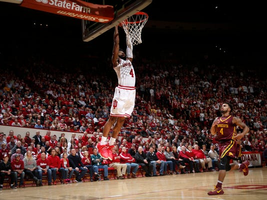 Indiana guard Robert Johnson scores on a breakaway dunk in front of Minnesota guard Jamir Harris during the second half of an NCAA college basketball game in Bloomington, Ind., Friday, Feb. 9, 2018. Indiana won 80-56. (AP Photo/AJ Mast)