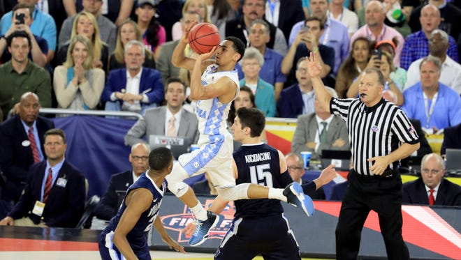 Marcus Paige makes a double-clutch 3-pointer with 4.7 seconds left in regulation in the national title game.