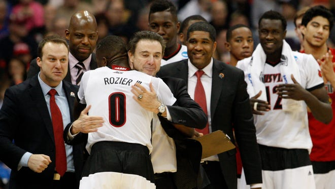 U of L head coach Rick Pitino hugs Terry Rozier, #0, in the closing seconds of their win over NC State during the Sweet 16 in the NCAA tournament game in Syracuse, NY.