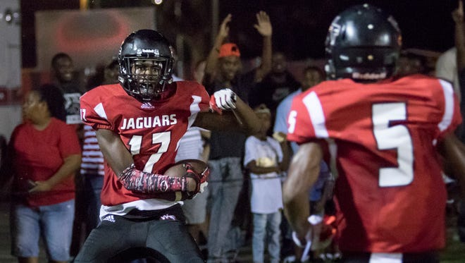 West Florida High's Keion Burrell celebrates after scoring a touchdown against Tate High on Sept. 1 at Woodham Middle School.