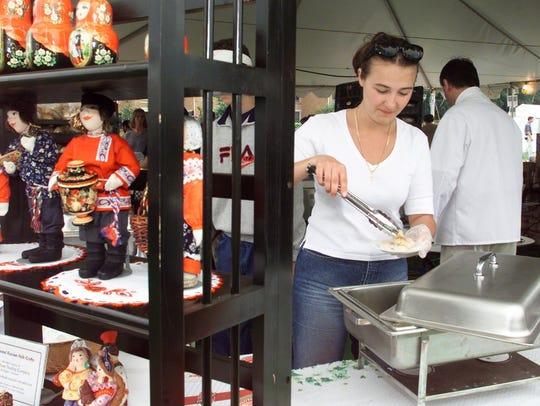 Anastasia Gerechin of a Taste of Russia serves potato