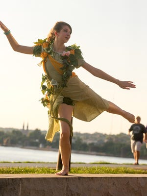 """Evansville Shakespeare Players actor Olivia Vincent dances as the Ivy Fairy in """"A Midsummer Night's Dream"""" during rehearsal at the Pagoda Monday evening."""